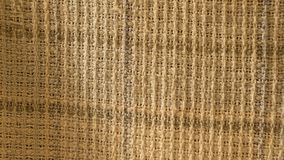 Close up of crumpled fabric texture, linen cloth textile background of light fabric with Crisscross wave. Natural canvas pattern. Background. Studio shot with stock image