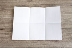 Close up of a crumpled unfolded piece of paper on wooden backgro Stock Photo