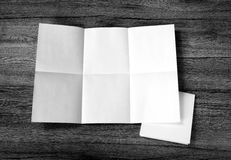 Close up of a crumpled unfolded piece of paper on wooden backgro Royalty Free Stock Image
