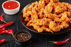 Close-up of crunchy corn flakes breaded shrimps stock photo