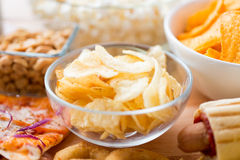 Close up of crunchy potato crisps in glass bowl Royalty Free Stock Photo