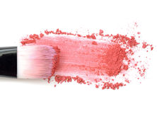 Close up of crushed blush on white background and cosmetic brush. Royalty Free Stock Photography