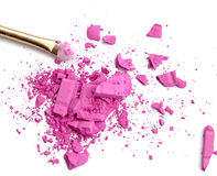 Close up of crushed blush on white background and cosmetic brush. Stock Photos