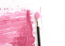 Close up of crushed pink color make up with brush on white Royalty Free Stock Photos