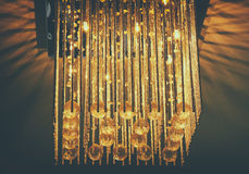 Close up of crystal chandelier , image is retro style filtered Stock Photos