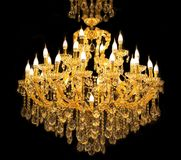 Close up on crystal of contemporary chandelier. Is a branched ornamental light fixture designed to be mounted on ceilings or walls. Black background stock images