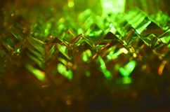 Close up of crystal facets in mysterious emerald green light. stock photo