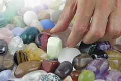 Close up of Crystal healer choosing a tumbled healing stone royalty free stock images