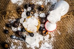 Close up of crystallized alum,Potassium alum and its powder with soap nut,Sapindus and salt,sodium chloride are the ingredients of. Traditional toothpaste made royalty free stock images