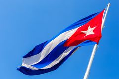 Cuban Flag Blowing in the Breeze. Close up of the Cuban flag waving in the breeze against a bright blue sky Stock Image