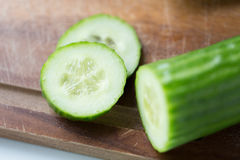Close up of cucumber on wooden cutting board Royalty Free Stock Images