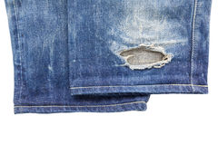 Close up of  cuff blue torn jeans  on white background Royalty Free Stock Photo