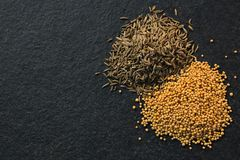 Cumin seeds and spice on black background Stock Image