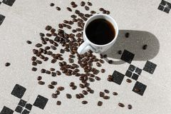 cup of black coffee grains Stock Photography