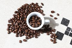 Cup of black coffee grains Stock Photos