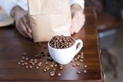 Close-up of cup with coffee beans Stock Images