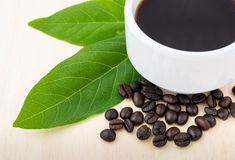 Close up cup of coffee with green leaf Stock Photography