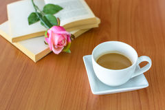 Close up of cup of coffee with pink rose Royalty Free Stock Image