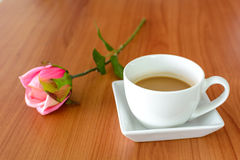 Close up of cup of coffee with rose Stock Photos