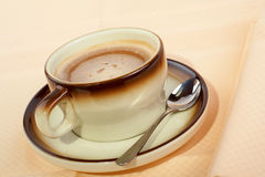 Close-up of a cup of coffee with the spoon Royalty Free Stock Photo