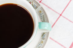 Close up cup of coffee. On the tablecloth Royalty Free Stock Images