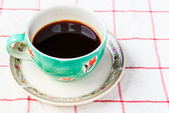 Close up cup of coffee. On the tablecloth Stock Image