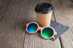 Close-up of cup of coffee on the white table. Morning, drinking. Coffee and sun glasses. Relaxing mood, break time Royalty Free Stock Photos