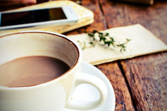 Close up of Cup of Coffee on wooden table in coffee shop Stock Images