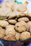 Close up of a cup full of homemade oats and nuts butter cookies. Royalty Free Stock Photos