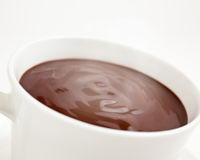 Close up of a cup of hot chocolate. Luxurious steaming hot chocolate swirling in a cup Stock Image
