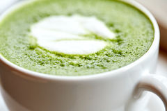 Close up of cup with matcha green tea latte Stock Image