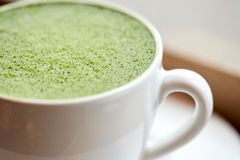 Close up of cup with matcha green tea latte Royalty Free Stock Photography