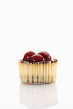 Close up of cupcake topped with chocolate cream and cherries aga Stock Photos