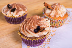 Close up of cupcakes with cinnamon on wooden table Royalty Free Stock Image