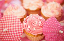 Cupcakes Decorated with Sprinkles, Frosting and Assortments Royalty Free Stock Image