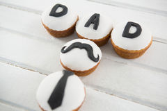 Close up of cupcakes with text on table Stock Images