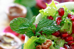 Close up of curly endive salad with pomegranate, nuts... Royalty Free Stock Photo