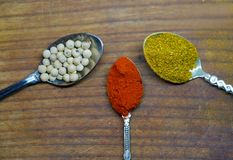 Close up of curry, pepper and paprika powder Royalty Free Stock Image