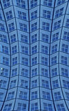 Close Up of Curved Blue High Rise Building Royalty Free Stock Photography