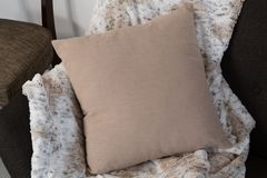 Cushion and blanket arranged on sofa. Close-up of cushion and blanket arranged on sofa royalty free stock photography
