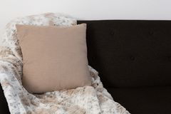Cushion and blanket arranged on sofa. Close-up of cushion and blanket arranged on sofa royalty free stock image