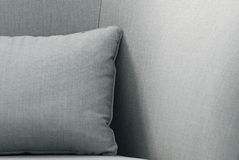 Close-up of a cushion on a sofa. Close-up of a gray cushion on a sofa royalty free stock photography
