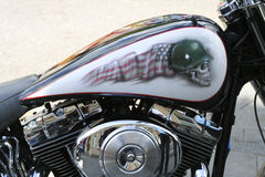Close up of custom motorcycle. A close up of a custom motorcycle with an american flag and a skull wearing a helmet on the gas tank Stock Images
