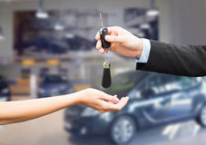 Close up of customer and salesman with car key Stock Images