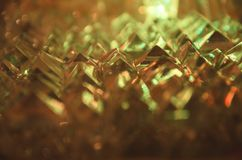 Close up of cut crystal in mysterious amber light. royalty free stock image