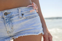 Close up cut offs and bikini bottom Stock Images