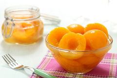 Cut peaches in glass jar Stock Photo