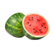 Close-up of a cut ripe watermelon isolated on a white background. Refreshingly sweet berry with small black seeds on the surface. Stock Photo