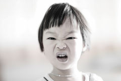 Close up cute Asian girl with angry face. Stock Image