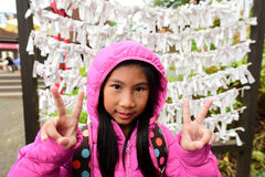 Close up of cute asian girl wearing pink jacket. In japan Royalty Free Stock Photo